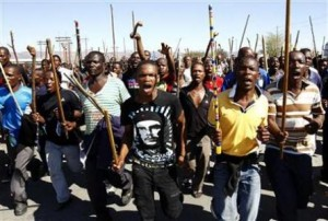 Mine workers take part in a march at Lonmin's Marikana mine in South Africa's North West Province