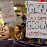 "Women shout slogans and hold up a placard that reads ""Against Sexism - Against Racism"" as they march through the main railways station of Cologne, Germany, January 5, 2016. About 90 women have reported being robbed, threatened or sexually molested at the New Year's celebrations outside Cologne's cathedral by young, mostly drunk, men, police said on Tuesday.   REUTERS/Wolfgang Rattay"